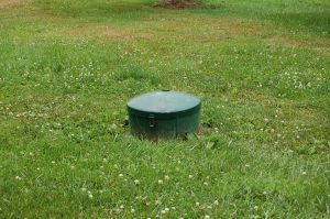 The first step in propane safety is to locate your propane tank. If it's below ground, look for something like this. The dome is commonly located 8-12 inches above ground and often painted green to blend in with it's natural surroundings.