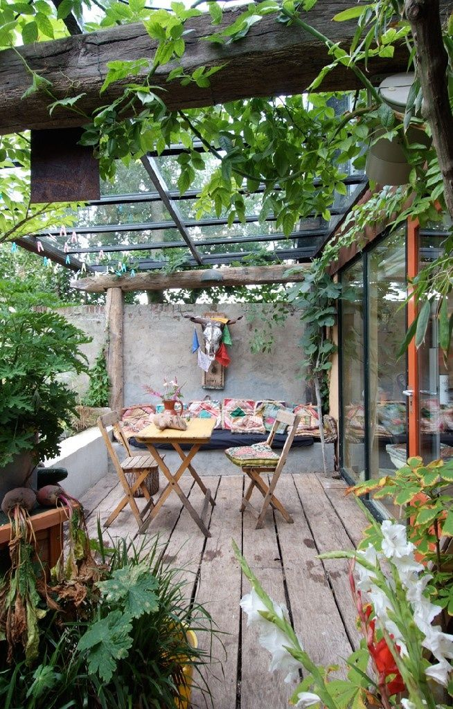 This gives me an idea to put skylights in the screened porch!   Small Garden with a Rustic Covered Terrace