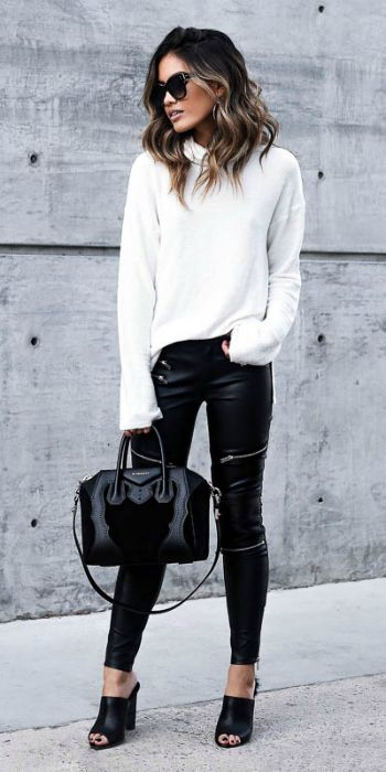Is there ever a better combination than black and white? + Jill Wallace + rocking + totally classic style + bright white sweater + leather leggings + ultimate striking contrast + simplicity + winter look!  Sweater: Planet Blue, Trousers: Zara , Shoes: Tony Bianco.