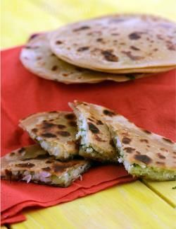 You might not have ever thought of bringing together cabbage and paneer since both are rather bland in nature – once you try this recipe, you will realise how well they complement each other in flavour and texture.    This paratha is a quick fix ideal for any day when you are in a rush. Serve hot with curds and your meal is ready!