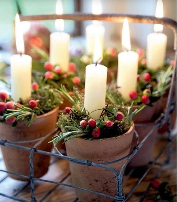 Simple, natural Christmas decorations are what I love. #thinkingaboutchristmas #naturalchristmasdecorations #candles #greenery #tinyteracottapots