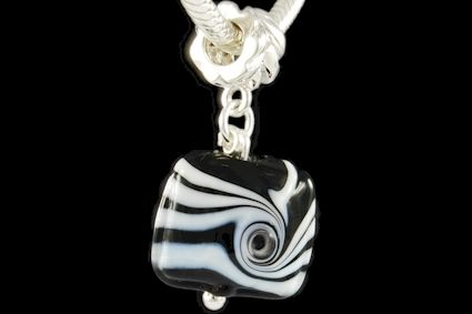 black and white glass, twisted decoration motif. Dimension mm. 15.