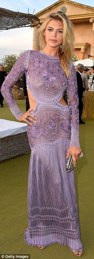 VIP: Leonardo's model girlfriend Kelly Rohrbach turned heads in her bold purple number, wi...
