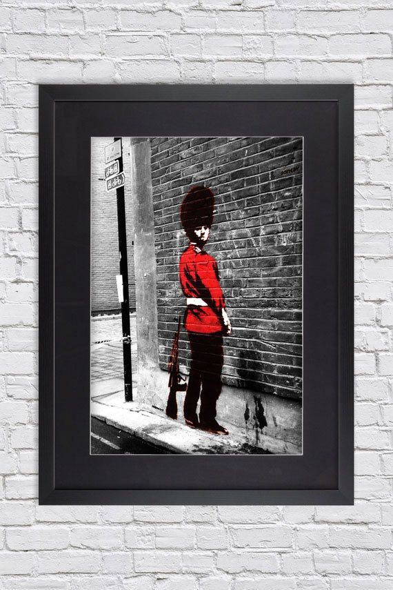 banksy queens guard pissing large mounted framed poster art print a2 31 x 24 inches 75 x 61 cm
