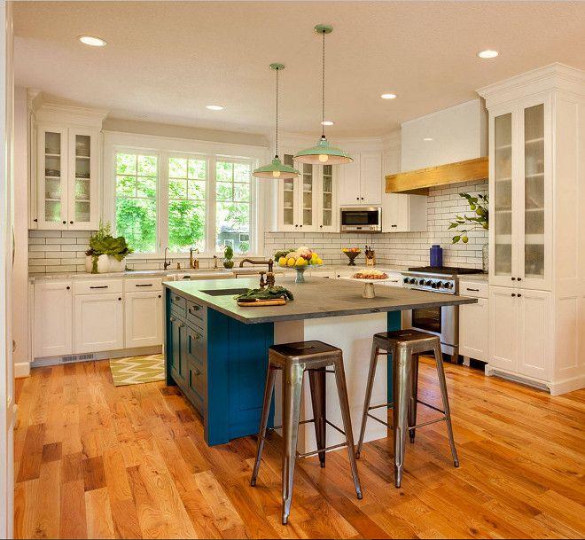 White Kitchen with Blue island paint color. White kitchen cabinet paint color is White Dove OC-17 Benjamin Moore. Blue island paint color is Benjamin Moore Naples Blue 2057-30. Garrison Hullinger Interior Design Inc.