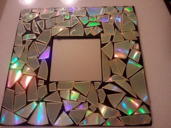 Break old CDs to create a mosaic frame.