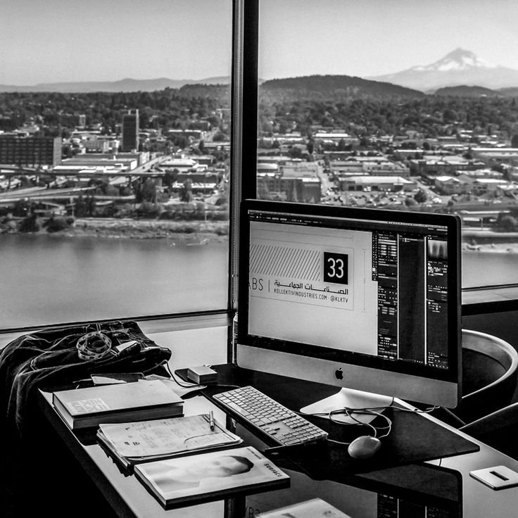 Designing high above the Willamette River in Downtown Portland w/ a view of Mt. Hood in the horizon.  ©Kollektiv Industries: Denim + Design Labs™  Black and White Photography. Rock on.