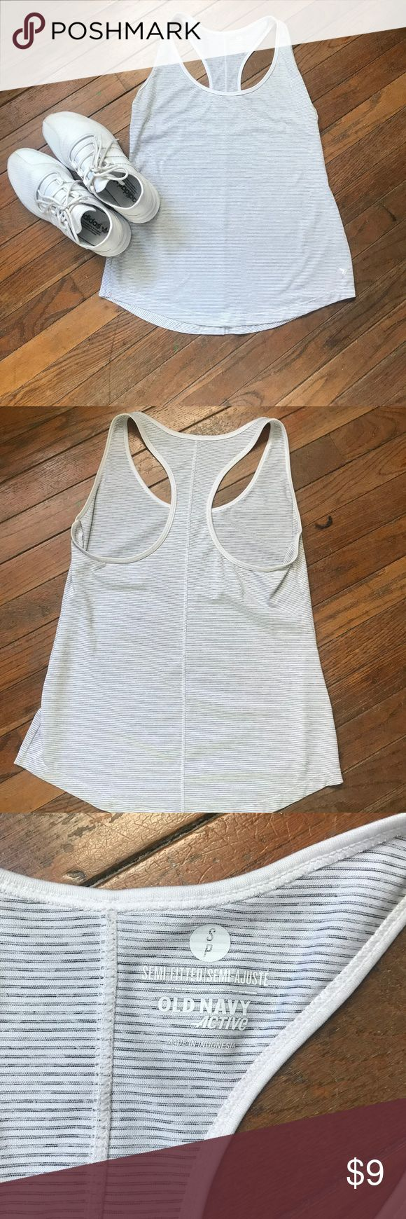 Old Navy Racerback Performance Striped Tank Rounded neckline.  Racerback.  Slight hi-lo hem.  Go-Dry: superior wicking keeps you comfortable and dry.  Super soft, moisture-wicking jersey, with added stretch.  Ultra-Light jersey is as versatile as your favorite everyday tank but built for peak active performance.  Open to offers :) no trades! Old Navy Tops Tank Tops