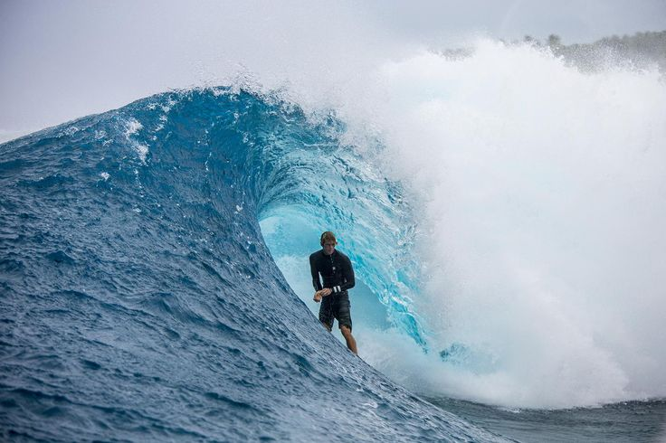 """In the the world of surfing, Ian Walsh stands apart.  A new documentary produced by Red Bull titled """"Distance Between Dreams"""" features Walsh tackling mountain-sized swells at surf spots located everywhere from Portugal to Hawaii.  The world class surfer recently spoke with Maxim about the dangers of big wave surfing, and how he chases storms around the globe.  When asked why he chose surfing as his life-long pursuit, Walsh stated, """"Whether I was surfing professionally or working in a…"""