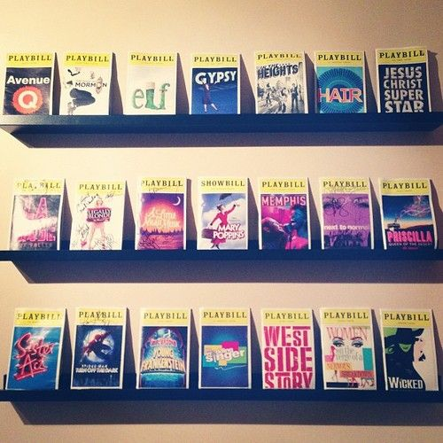Playbill Display - like that you can still pick one up and look at it...also cheaper than framing each one separately...
