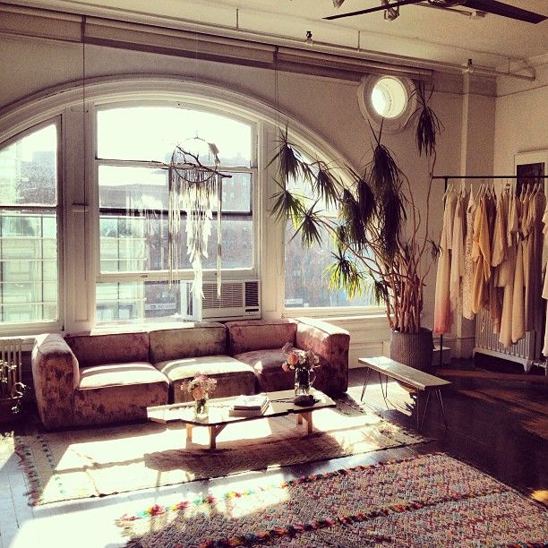 Velvet Deco Sofa, Mixed Rugs, Arched Apartment Windows | Living Room