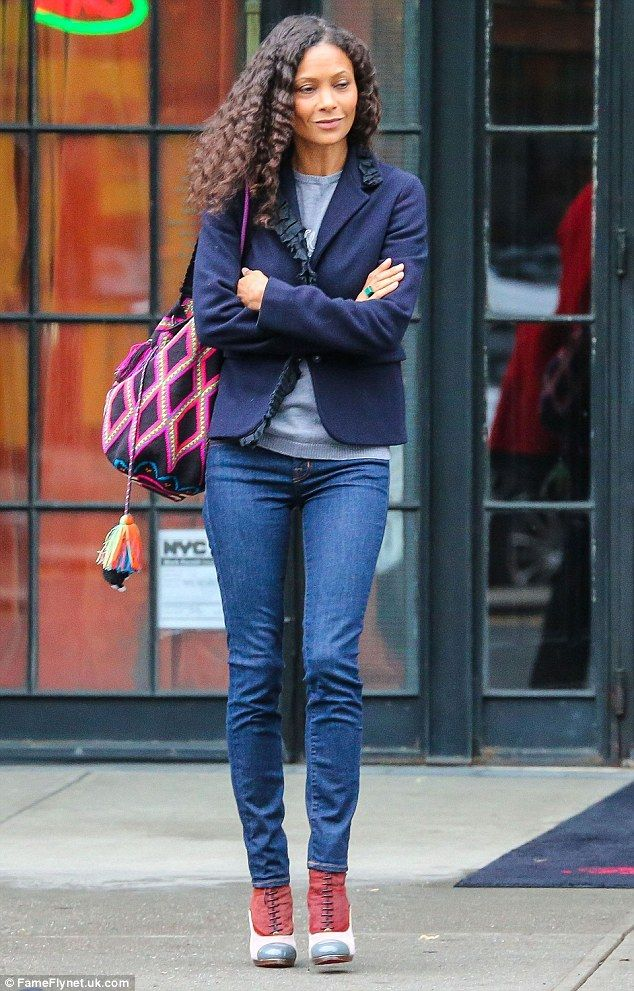 Shoe-business: Thandie Newton looked lovely in a fitted jacket, jeans and statement boots ...