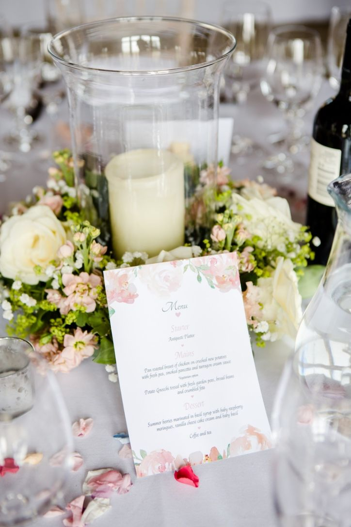 Hurricane lamp flower table centre at The Long Barn, Newton Valance by Fiona Curry Flowers.  Photo by Lydia Stamp Photography