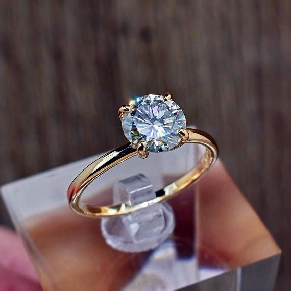 14k Solid Gold Moissanite Gemstone Ring. • This listing is for the Moissanite ring only, it does not include the optional wedding band shown in last few sample photos. • This is a beautifully faceted, high quality Moissanite gemstone ring with brilliant colorful flashes with each and every #solitairering