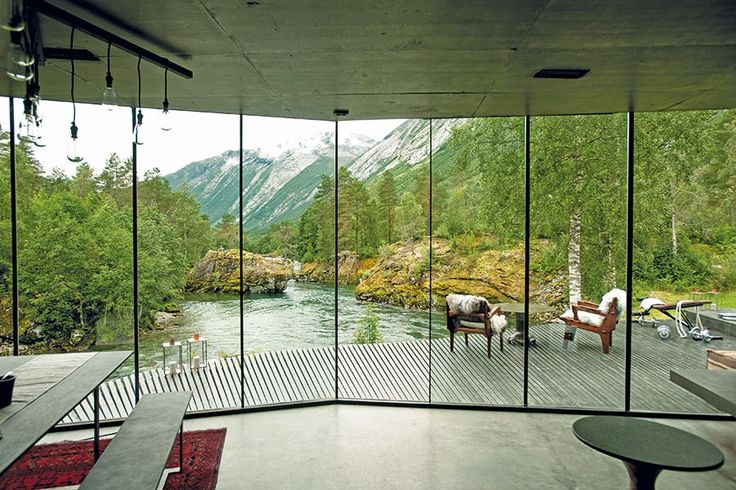 The Juvet Landscape Hotel's guest suite looks onto a glacier-fed river. To suggest the lifestyle of the tech genius, filmmakers went for a spare but tasteful aesthetic.