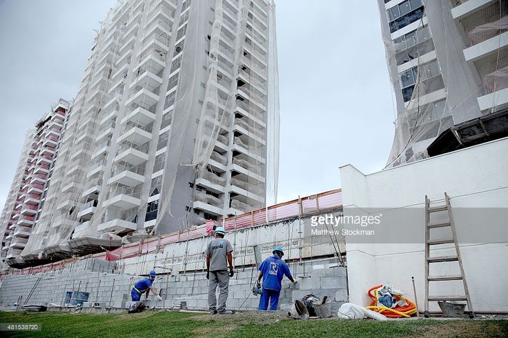 Construction progress takes place during a tour of the Ilha Pura housing complex, the future site of the Athletes' Village for the Rio 2016 Olympic Games, on July 21, 2015 in Rio de Janeiro, Brazil.