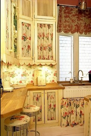 Fabric inset cupboard doors, scalloped trim, wallpaper and wood counter top....beautiful combination
