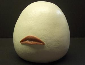 Long-distance kiss simulator...replicates your lover's kiss via the Interwebs. Some find it gross, I find it whimsical!
