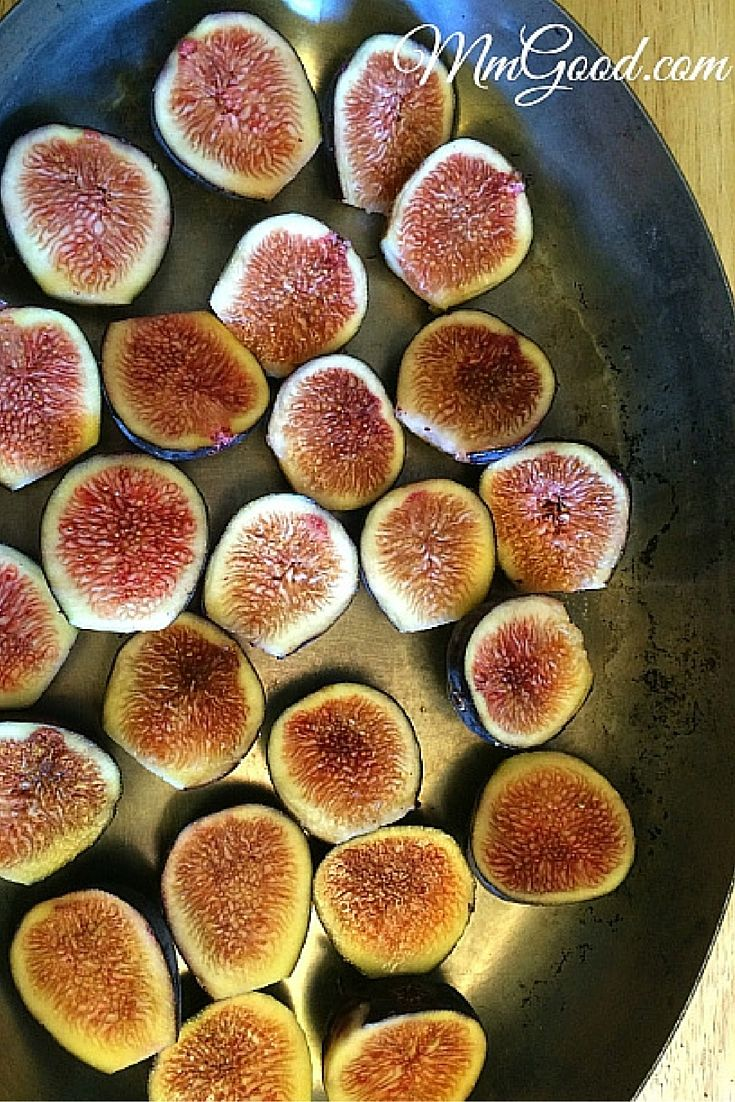 Baked figs with honey and cinnamon, garnished with toasted sliced almonds...then placed upon your ice cream...#YUMMMY! This is the simplest dessert recipe for baked figs that you make and it will leave a lasting memory for your friends!!! | www.MmGood.com