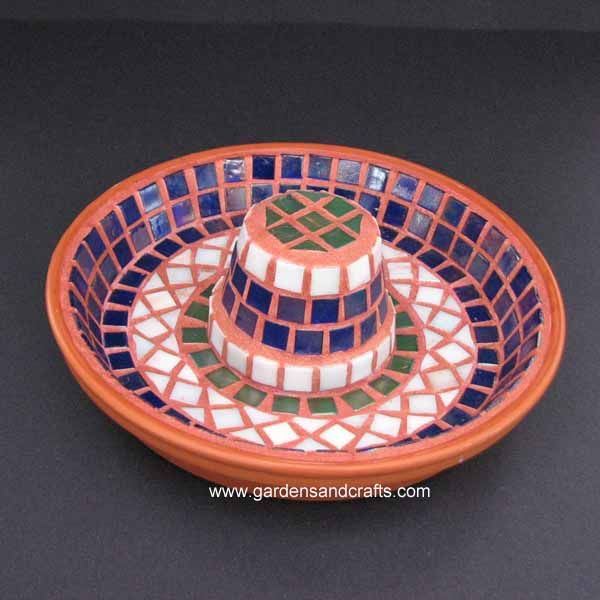 Mosaic Birdbath, made out of terra cotta pots. This website includes a list of all materials