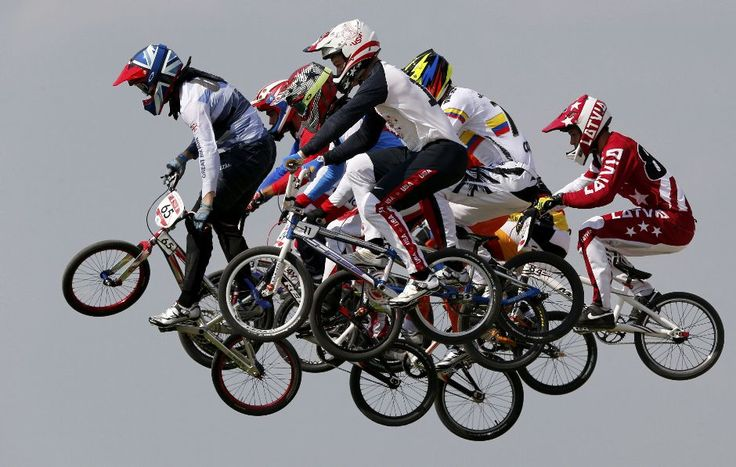 Competitors take part in the men's BMX quarter-final run during the London 2012 Olympic Games at the BMX Track in the Olympic Park.