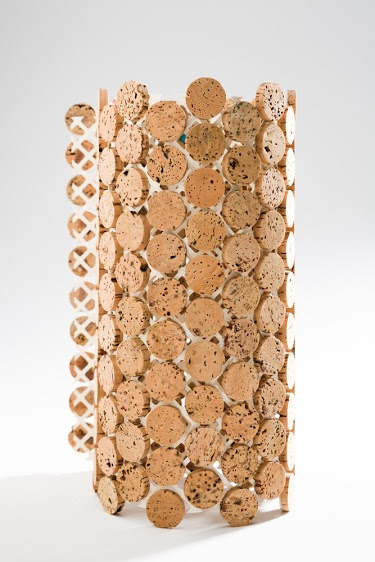 : Sustento Design : VINI Cork line gives a new purpose to wine corks after that last glass has been poured. These cork mosaic tiles are produced from discarded wine corks, which are cut into circular discs and glued onto a special paper backing with the use of a water base adhesive, making it flexible enough to be used on round surfaces as well (as shown in picture).