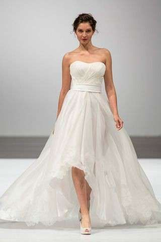 DRESS GIUSEPPE PAPINI 2014 ASYMMETRICAL TULLE: The skirt is presented as a soft cloud.