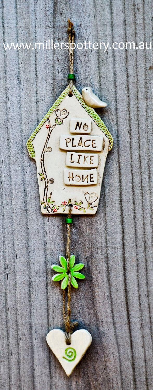 Australian handmade ceramic house mobile by www.millerspottery.com