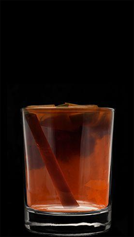 SquidBite - 1 part Kraken, 3 parts warm apple cider, cinnamon scroll, apple slices