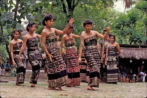 Indonesia, sawu (Seba) Island natives in ikat costumes performing traditional dances