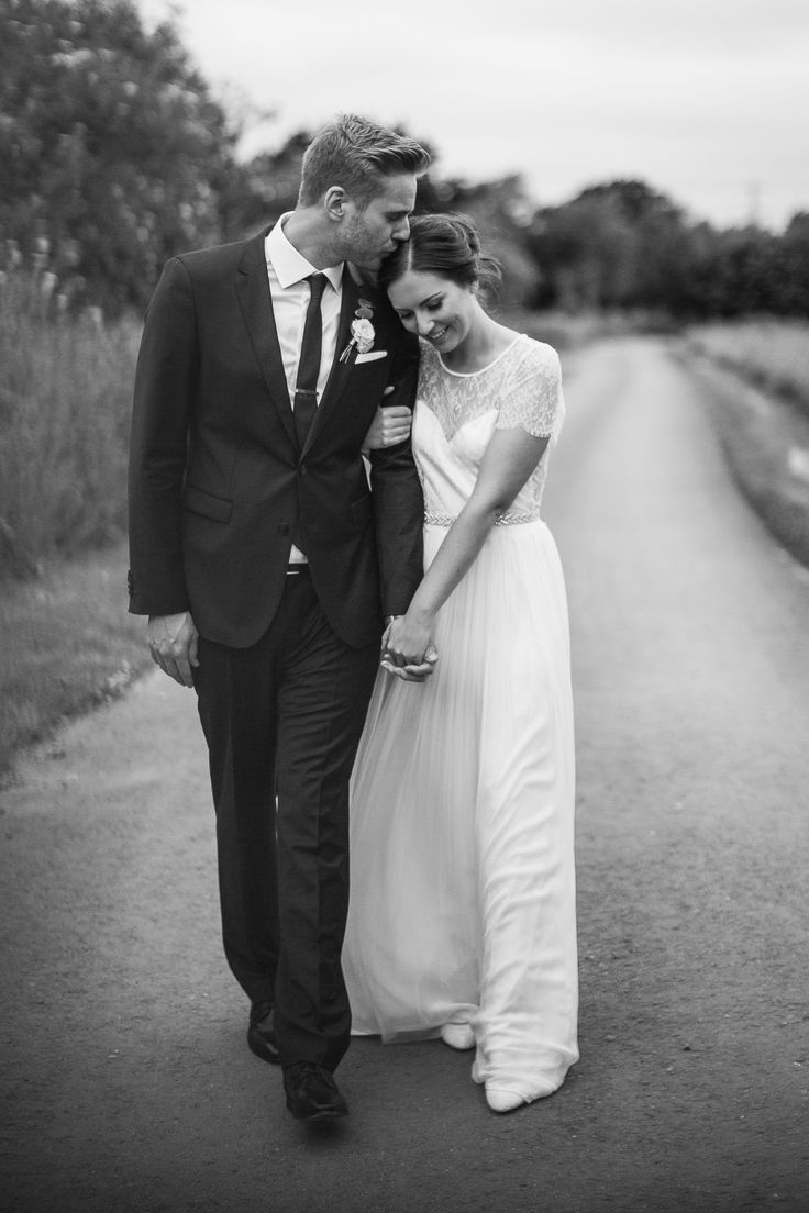 Shustoke Farm Barns wedding, Warwickshire, England. Bride and Groom, dress by Phoebe Blockley Bridal. Katie & Ross by D&A Photography, a Contemporary UK & Destination Wedding Photographer. #boho #bride #sleeves #lace
