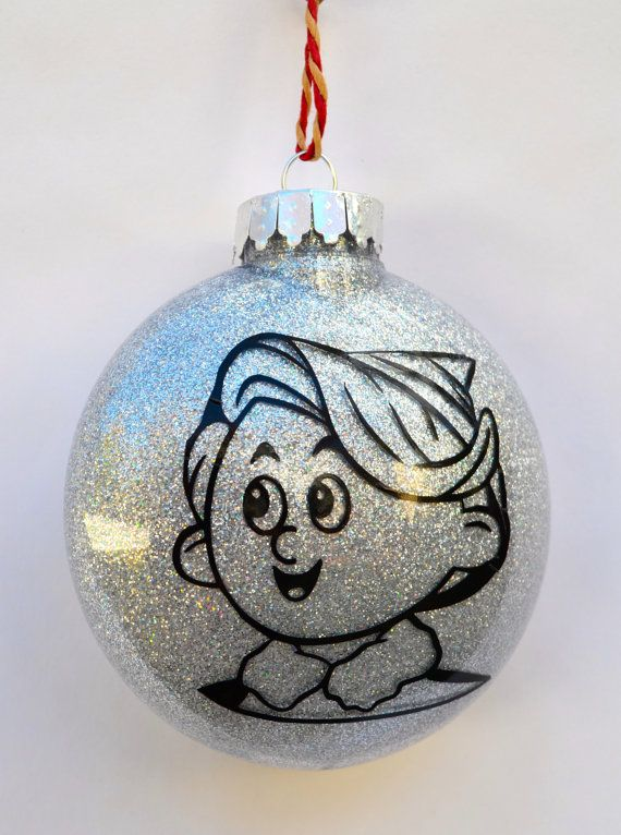 A beautiful shatterproof Christmas ornament featuring the adorable face of Hermey the Elf from the TV special Rudolph the Red Nosed Reindeer.  This disc shaped ornament is filled with brilliant silver glitter (no mess or shedding of glitter all over the place!) and is covered with a shiny black decal of everyones favorite aspiring dentist, Hermey the Elf, D.D.S  The ornament measures 100mm.  If you want the other Rankin/Bass characters or special ornaments just check out my other listing...