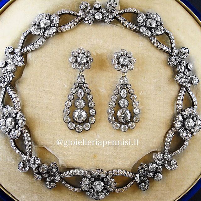 We just sold this two wonderful 19th century pieces to a Milanese Lady. The necklace, with 42 carats of old-cut diamonds is by AE Kochert, the Imperial Jeweller in Vienna. The earrings are italian and were previously in a Princely Family. They perfectly matched!