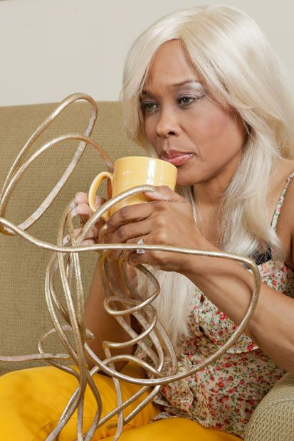 Chris Walton, known as The Dutchess, drinks coffee with fingernails stretching and curving from her hands like a tangle of spaghetti. Meet the 45-year-old grandmother with the world's longest fingernails. This Las Vegas singer and musician stopped cutting her fingernails 18 years ago and now her nails have reached a total of 20 feet. Her amazing dedication to her nails has been officially recognised by the 2012 edition of the Guinness Record Book.
