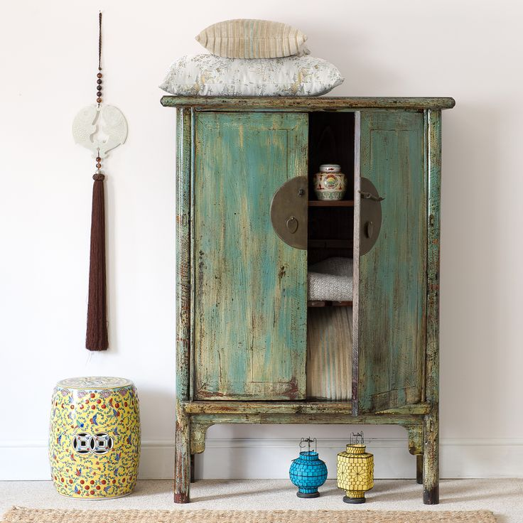 A beautiful Chinese pine cabinet c.1920 Shandong Province, with a handsome turquoise and cream distressed finish http://www.orchidfurniture.co.uk/turquise-and-white-distressed-cabinet-shandong-province-c-1920: