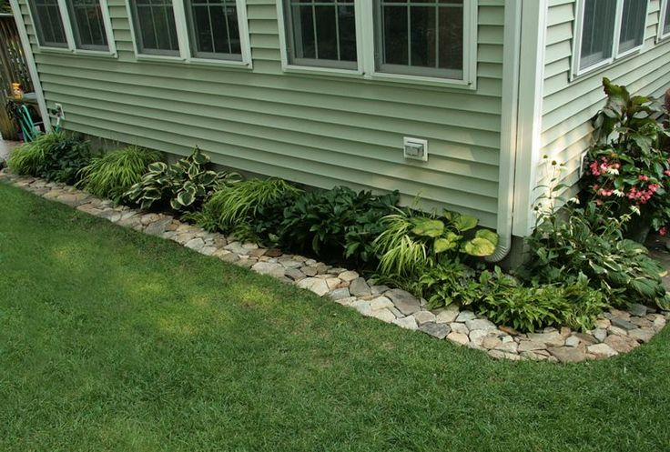 Love this rock border put down a weed barrier cardboard for Rock garden edging
