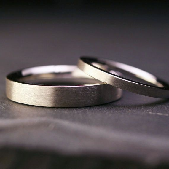 Set of sterling silver flat wedding bands brushed by hartleystudio, $235.00. I want them in traditional gold, though