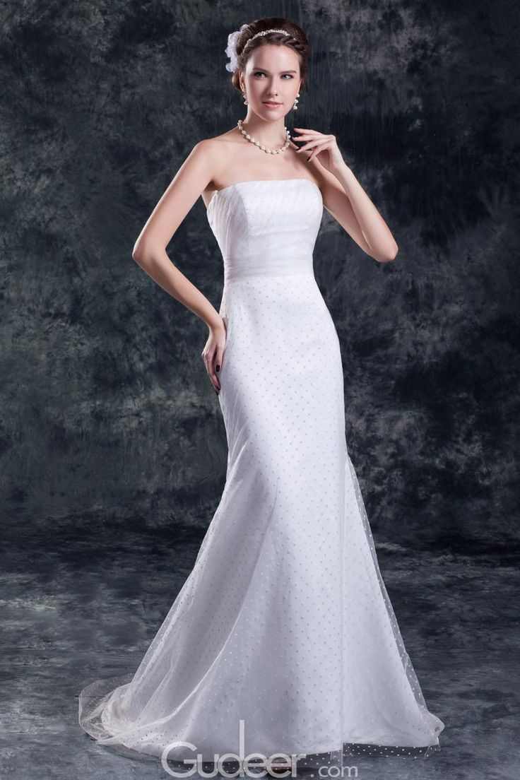 Designed with romance and elegance in mind, this ivory organza fit and flare wedding gown is the epitome of classic beauty! Refined strapless straight bodice offers delicate ruching and underlay into contrasting ruching empire waist, mermaid skirt accentuate your curve and creates movement while sheer organza covers the full dotted satin to create hazy beautiful.