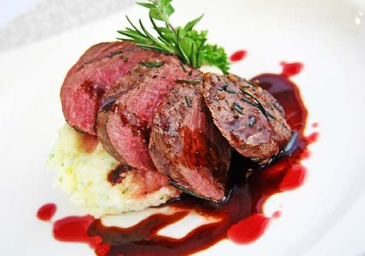 Grilled Ostrich with Cranberry and Red Wine Reduction on Herb Buttered Mash Potato