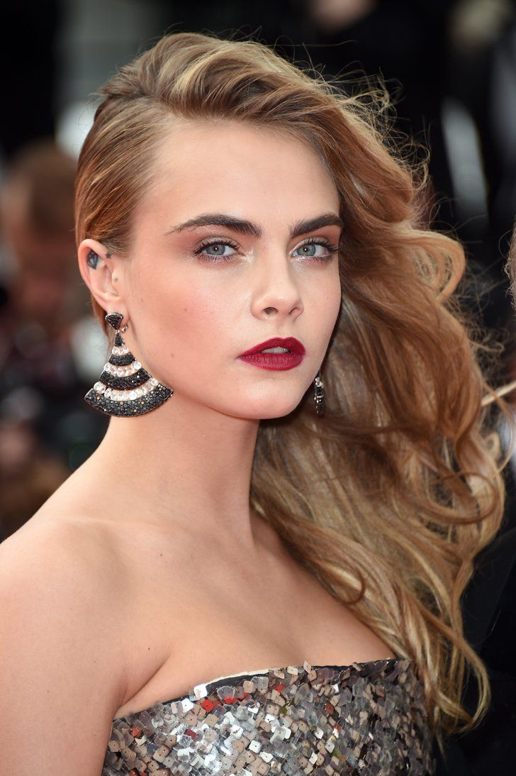 Pin for Later: Models Light Up the amfAR Runway With Red-Hot Lips Cara Delevingne At the Search premiere at Cannes, Cara's hair was swept to one side, while her makeup was a mix of smoky shadow and a brick-red lip.