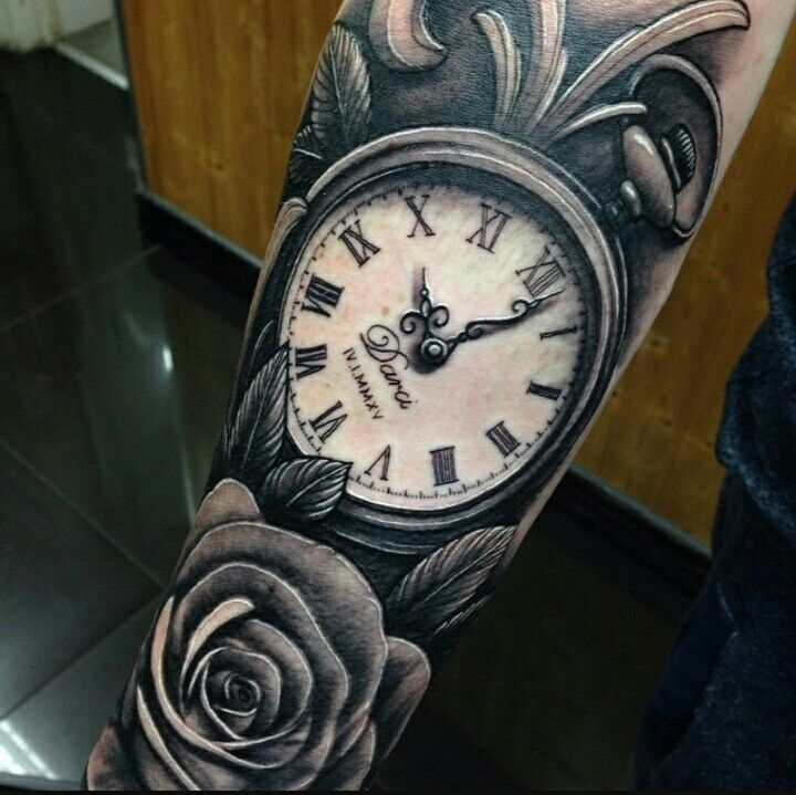Modern pocket watch and rose forearm tattoo