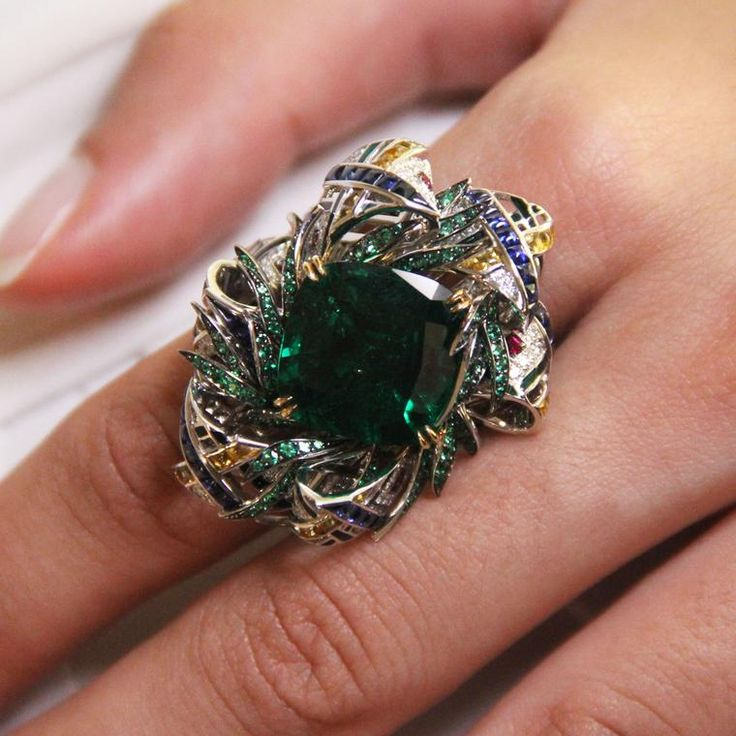 Large emerald ring from Chaumet's est une fête high jewellery collection, with rubies, sapphires, yellow sapphires and white diamonds. http://www.thejewelleryeditor.com/jewellery/article/chaumet-est-une-fete-high-jewellery-review/ #jewelry