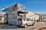 """Starbucks Opens Drive-Thru Made from Recycled Shipping Containers in Northglenn, CO - """"it's so small, there is no indoor seating this is pretty cool— it's only intended for drive-thru and walk-up customers. The diminutive building is made from two shipping containers that are clad in local snow fencing, which conceals the modular structure and gives the shop a warm tone."""""""