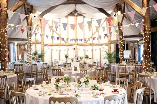I love the bunting hung high in the rafters for this reception.