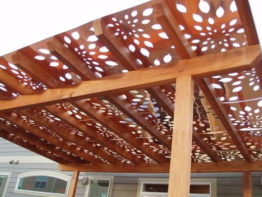 Build a pergola and cover it with these panels. Awesome shade and awesome look!!