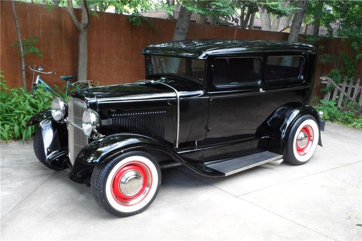 1930 FORD  CUSTOM 2 DOOR SEDAN All-steel, chopped, 1930 Ford custom with ribbed roof, '32 Grille shell, 383 stroker small block Chevy motor and new wide white radials.
