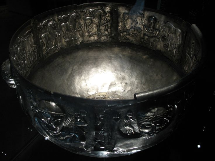Gundestrup Cauldron Peat bog, Gundestrup (Denmark) First century B.C.E. Silver partially gilded. Diameter 69cm., Height 42cm.Copenhagen, Nationalmuseet.   The Gundestrup Cauldron is a religious vessel found in Himmerland, Denmark, 1891. It was deposited in a dry section of a peat bog, dismantled with its five long rectangular plates, seven short ones and one round plate. Each plate is made of 97.0% pure silver and filled with various motifs of animals, plants and pagan deities.