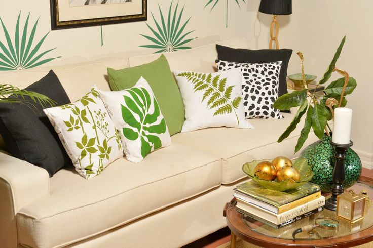 A DIY stenciled accent wall using the Palmetto Leaf Wall Art Stencil from Cutting Edge Stencils and painted accent pillows from Paint-A-Pillow. http://www.cuttingedgestencils.com/palm-leaf-stencil-palmetto-wall-decor.html