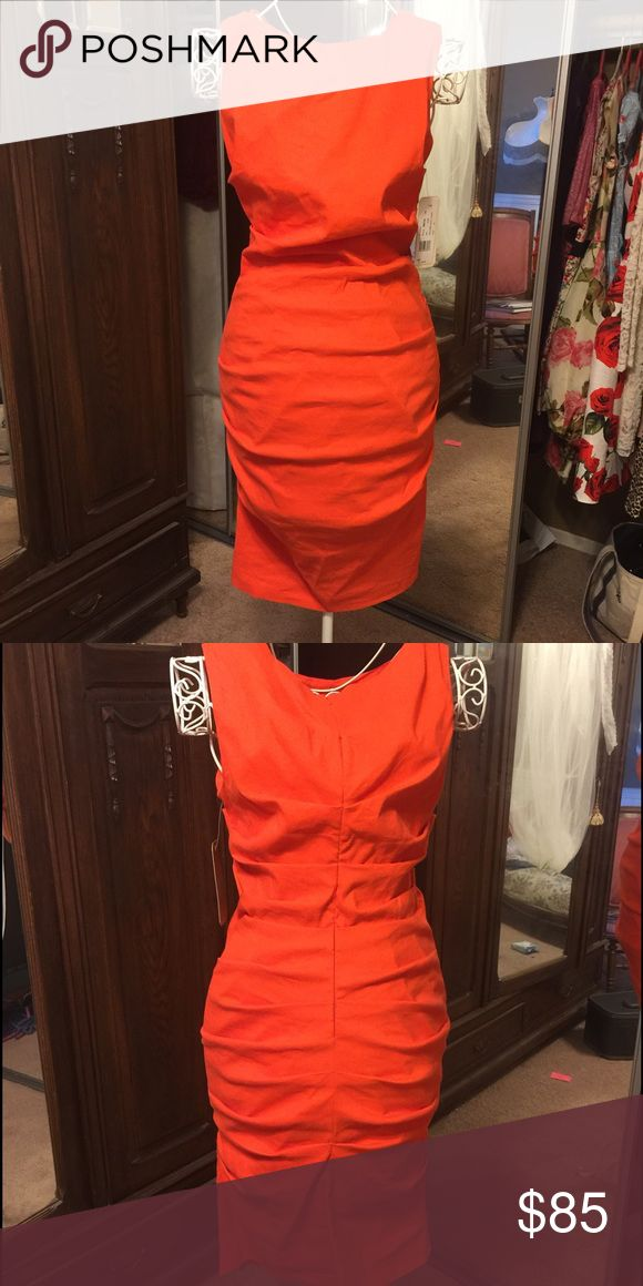 Form fitting orange formal dress, new with tags. Form fitting dress, new with tags, never worn. Great for weddings or work. Dresses Mini