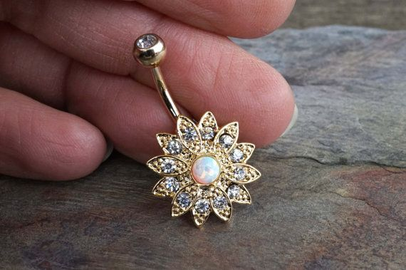 Gold opal belly button rings flower with a band of crystals that surround the center white opal. Will arrive in a gift box. The white opal belly | $29.00